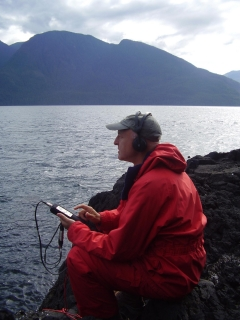 Chris Watson recording underwater sounds using a hydrophone (source: http://www.chriswatson.net/)